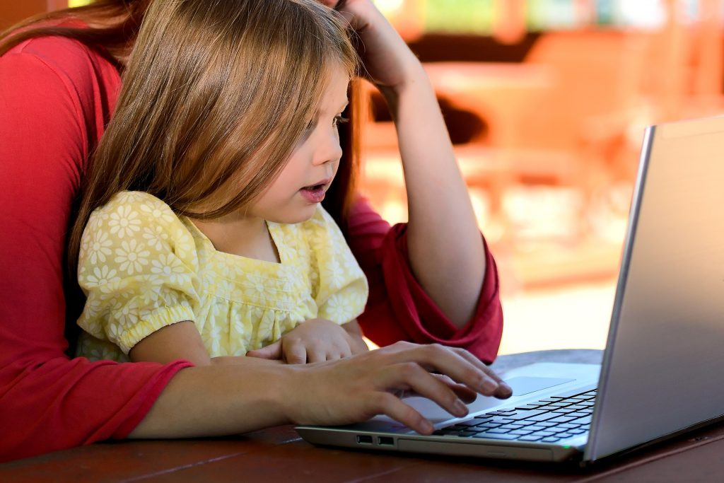 parent with child on laptop