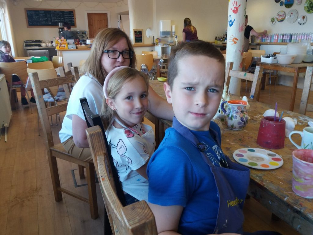 a woman, a girl and a boy at a table