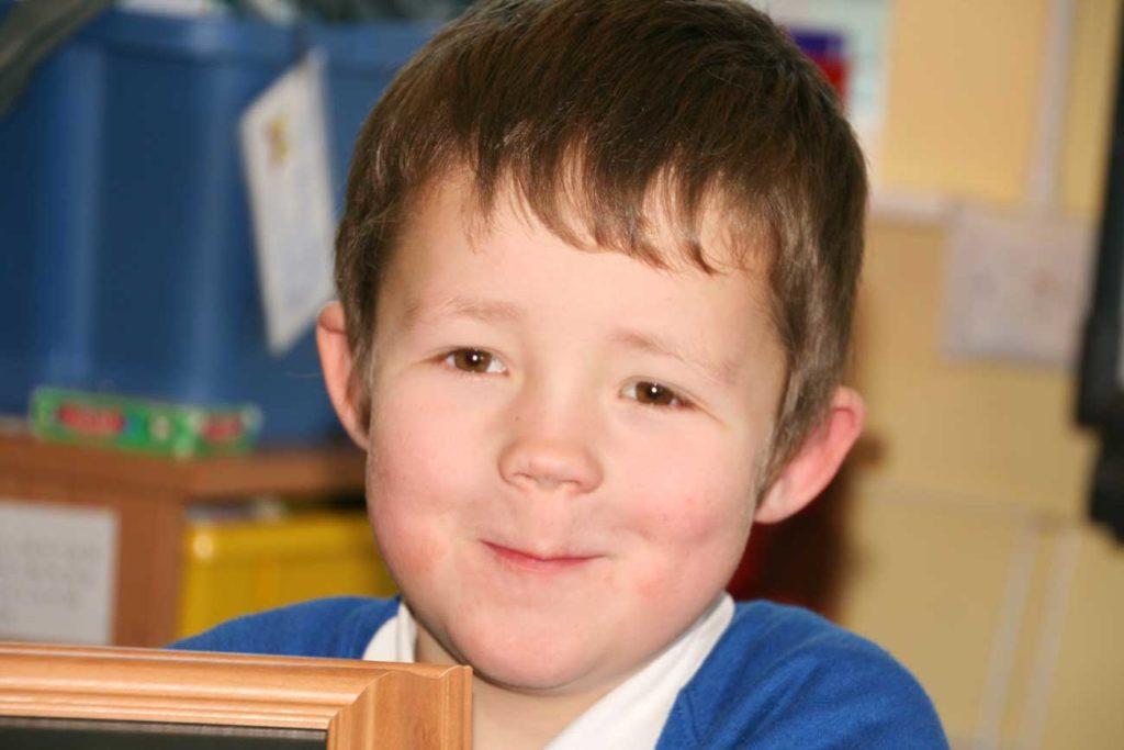 close up of boy in school uniform