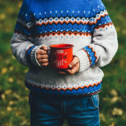 boy holding mug