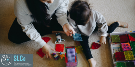 Mother and child playing with toys on a carpet